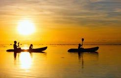 Family kayaking at sunset Stock Image