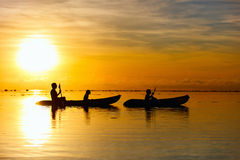 Family kayaking at sunset Stock Image