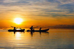 Family kayaking at sunset Stock Images