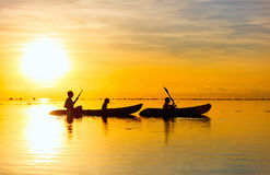 Family kayaking at sunset Stock Images