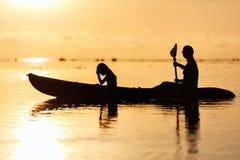 Family kayaking at sunset Stock Photography