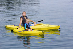 Family Kayaking together on a beautiful lake Stock Images
