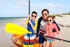 Family kayaking at tropical ocean Royalty Free Stock Photos
