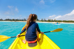 Family kayaking at tropical ocean Stock Images