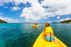 Family kayaking at tropical ocean Stock Photos