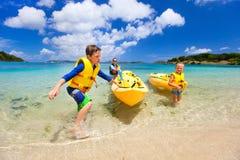 Family kayaking at tropical ocean Stock Photo