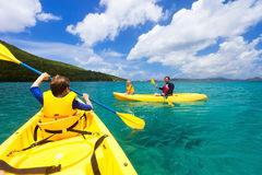 Family kayaking at tropical ocean Royalty Free Stock Images