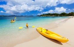 Family kayaking at tropical ocean Stock Photos