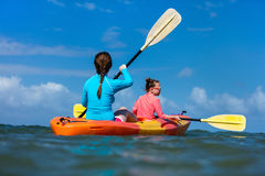 Family kayaking at tropical ocean Royalty Free Stock Photo