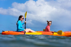 Family kayaking at tropical ocean Royalty Free Stock Photography