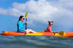 Family kayaking at tropical ocean Royalty Free Stock Photography