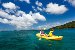 Family kayaking at tropical ocean Stock Photography