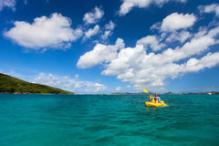 Family kayaking at tropical ocean Stock Images