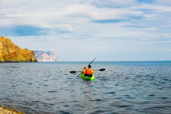 Family on kayaks and canoe tour. Father and child paddling in kayak in a river on a sunny day. Children in summer sport royalty free stock images