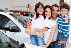 Family with keys of new car Royalty Free Stock Photography