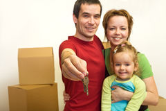 Family with the keys of their new home Royalty Free Stock Photos
