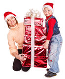 Family with kid giving Christmas gift box. Stock Photo