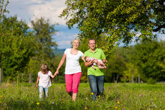 Family with kid having walk in summer Stock Photography