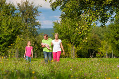 Family with kid having walk in summer Stock Images