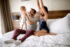 Family with kid in the morning. Happy mother, father and baby ch royalty free stock images