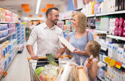Family with kid picking cleaning products Royalty Free Stock Image