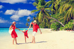 Family with kid playing on tropical beach Royalty Free Stock Images