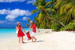 Family with kid playing on tropical beach Royalty Free Stock Photo
