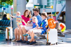 Family with kids at airport Royalty Free Stock Photos