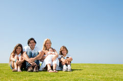Family with kids and baby in field Royalty Free Stock Photo
