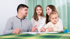 Family with kids with documents at home Stock Image
