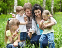 Family with kids eating ice-cream. Royalty Free Stock Photo