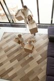 Family kids entering new home carrying boxes on moving day royalty free stock photography