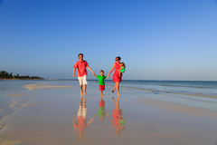 Family with kids having fun on tropical beach Stock Photos