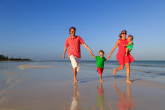 Family with kids having fun on tropical beach Royalty Free Stock Images