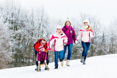 Family with kids having winter walk in snow Royalty Free Stock Image