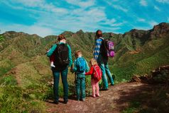 Family with kids hiking travel in mountains. Tenerife, Spain stock image