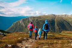 Family with kids hiking travel in scenic mountains, Norway. Europe royalty free stock images