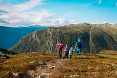Family with kids hiking travel in scenic mountains, Norway. Europe royalty free stock image