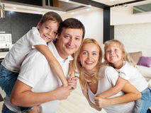 Family with kids at home Stock Images