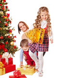 Family with kids open Christmas gift box. Royalty Free Stock Photo