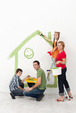 Family with kids painting their home Royalty Free Stock Photography