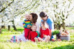 Family with kids on picnic in spring garden stock photography