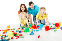 Family with kids playing toys blocks Stock Images