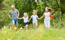 Family and children run in nature stock photos