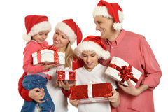 Family with kids   in santa hats Royalty Free Stock Photo