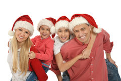 Family with kids   in santa hats Royalty Free Stock Image
