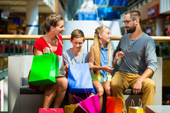 Family with kids shopping in mall. Having a break stock image