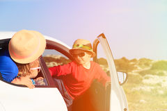 Family with kids travel by car in mountains Stock Images