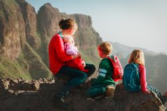 Family with kids travel hiking in mountains looking at view. Mother with kids travel hiking in mountains looking at view stock photos