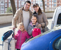 Family with kids with trollers near car Stock Image
